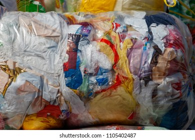 Colored plastic bags are packed in a bale. Separately collected plastic bags will be recycled