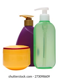 colored plastic bottles with liquid soap and shower gel isolated on white background .