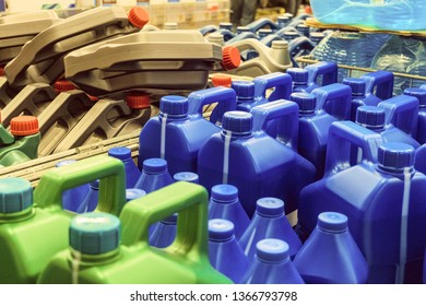 Colored plastic cans with engine oil. Canisters placed on a pallet.