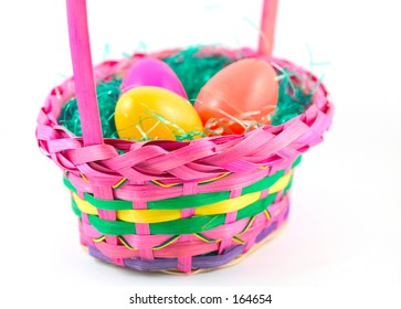colored plastic easter eggs in a brightly colored basket.