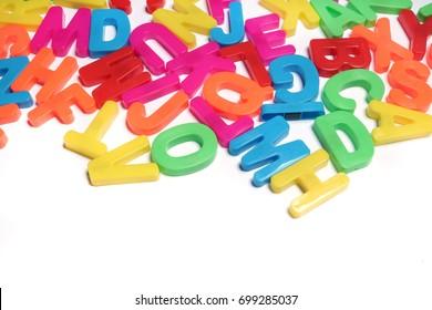 Colored plastic letters. Alphabet.