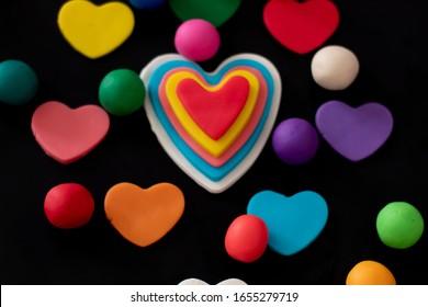 colored plasticine hearts black background 260nw 1655279719