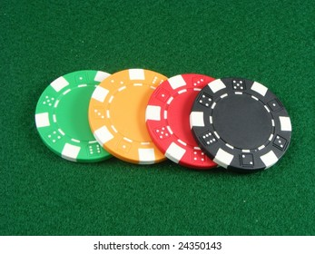 Colored poker chips on card table