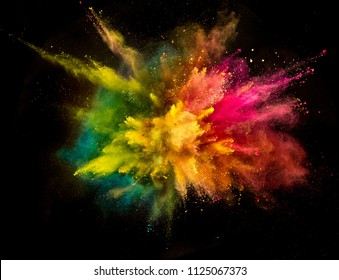 Colored powder explosion isolated on black background. Frozen motion.