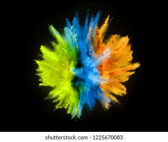Colored powder explosion isolated on black background.
