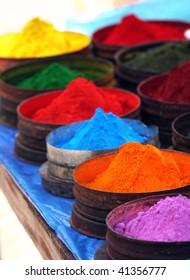 Colored powders at market in Pisac, Peru