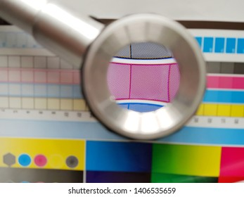 Colored printing. CMYK. Magnifying glass. Color palette.