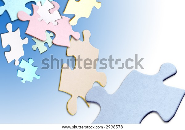 Colored puzzle pieces floating over a white background