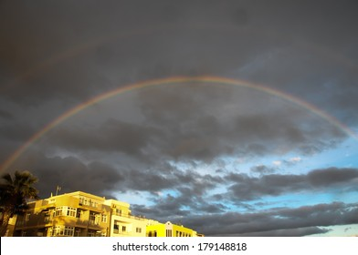 Colored Rainbow over a Cloudy Sky in Tenrife Canary Islands