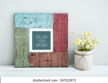 colored red, green, blue frame with place for text  chamomile in diy concrete pot. Scandinavian style room interior