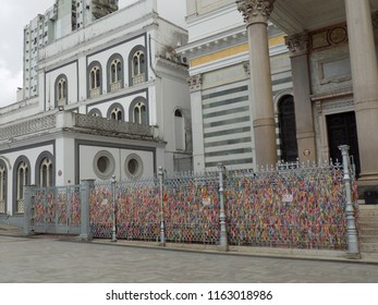 Colored ribbons representing promises made by believers, tied in a grid next to the Basílica Nossa Senhora de Nazaré (church) at Belem, Brazil