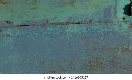 Colored rusty stained metal wall texture pattern