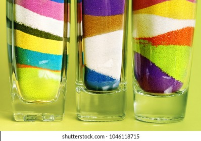 Colored sand poured in layers in a bottle?