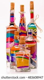 Colored sand poured in layers in a bottle