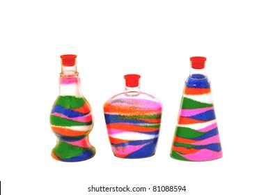 Colored sand poured in layers in a glass jar