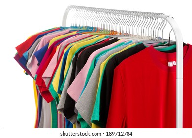 Colored shirts on hangers steel. Isolate on white.