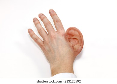 Colored silicone human ear made final product. Attached on human hand. Isolated on white background.