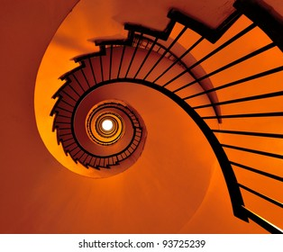 Colored Spiral stairway of an old building in Milan/Into the light