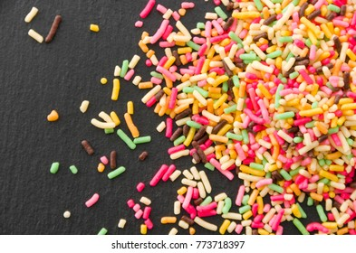 Colored sprinkles,decoration for cake and bekery, Colored sprinkles on black plate