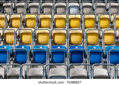 Colored stadium chairs. A field of empty stadium seats.