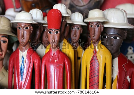 81387a49 Colored statues of men from abidjan in ivory coast. Painted statues  represent colons former french