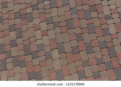 Colored stone blocks paving texture and background