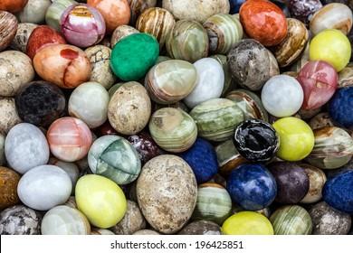 Colored stone onyx eggs in fabric, Turkey