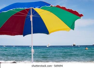 colored sun umbrella on the beach of St. Tropez