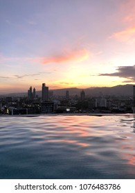 Colored Sunset View from Rooftop Infinity Pool