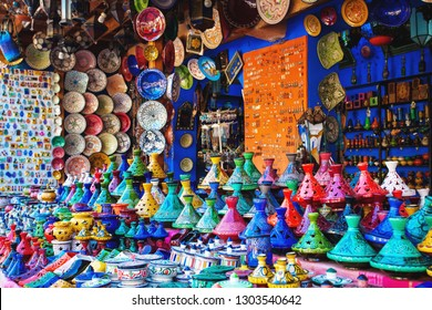 Colored Tajine, plates and pots out of clay on the market of Chefchaouen in Morocco. Moroccan Medina