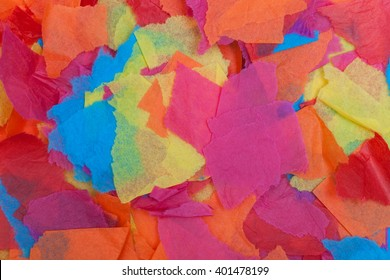 Colored tissue paper torn in different sized pieces