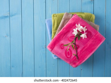 colored towels and flowers