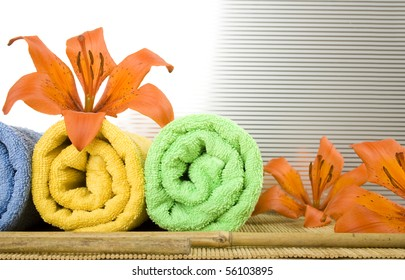 Colored towels are folded to lie next to them flower tiger lily