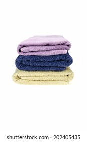 Colored towels folded on a white background.