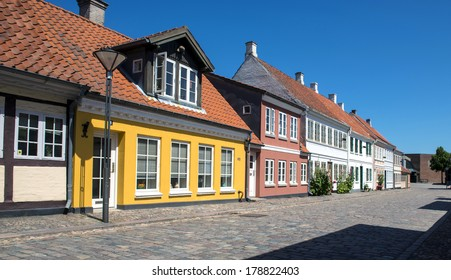 Colored traditional houses in a row in Odense, Denmark.