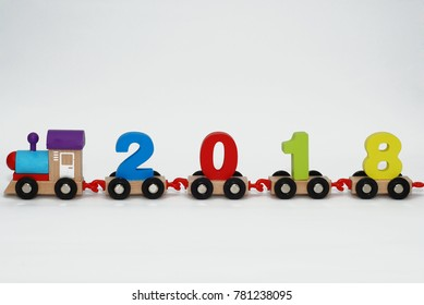 colored train with figures of the new year 2018