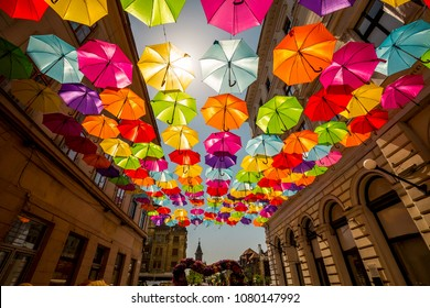 Colored umbrellas hanging between buildings, festival days in Timisoara, Romania