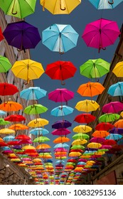 Colored umbrellas hanging between buildings, festival days in Timisoara, Romania