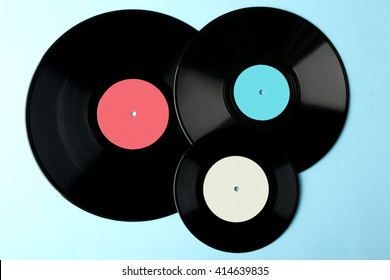 colored vinyl plate on blue wooden background