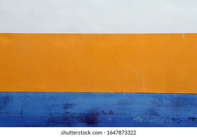Colored wall (white, orange and blue)
