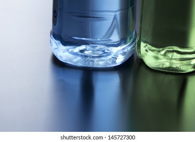 colored water in a bottle, detail, nice reflection on a surface
