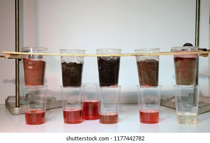 Colored water is poured trough 5 samples of soil:(l>r)sand, sandy soil, peat, humus and clay. The soil types ability to store and filter water (for pesticides) can be observed.