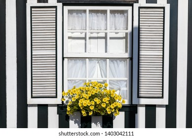 """Colored Windows of """"Costa Nova do Prado"""", Portugal. Windows in typical small wooden house with colorful stripes in Costa Nova. Aveiro. Portugal. Detail of the house in famous resort Costa Nova."""