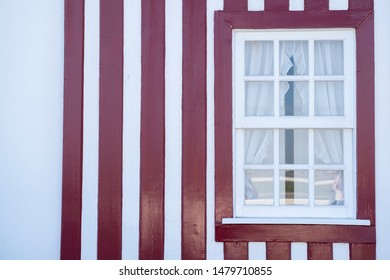 """Colored Windows of """"Costa Nova do Prado"""", Portugal. Windows in typical small wooden house with colorful stripes in Costa Nova. Detail of the house in famous resort Costa Nova."""