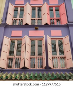 colored wood windows of the building colorful background.
