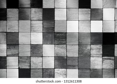 Colored wooden block aligned like a mosaic, in monotone.