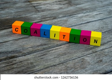 colored wooden cubes with letters. the word coalition is displayed, abstract illustration