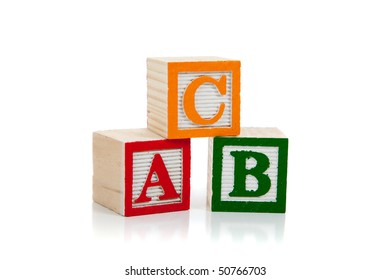 Colored wooden letter blocks including red, green and yellow on a white background with copy space
