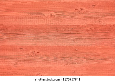 Colored wooden wall of brightly red color, texture for a background