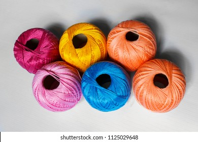 Colored yarn on a gray background. Skeins of wool yarn for knitting. Three colored skeins of yarn